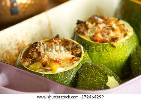 Baked round zucchini stuffed with minced meat, vegetables, and cheese - stock photo