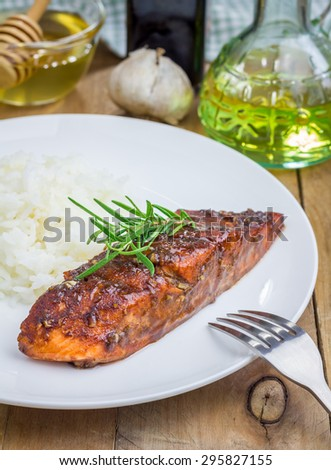 Baked salmon fillet in balsamic-honey sauce with rice  - stock photo
