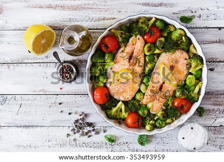 Baked salmon steak with vegetables. Diet menu. Top view  - stock photo