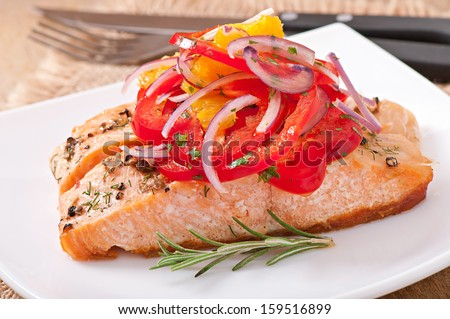 Baked salmon with a salad of sweet peppers and oranges - stock photo