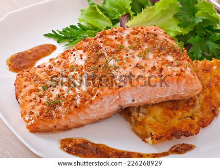 Baked salmon with honey-mustard sauce and potato gratin - stock photo