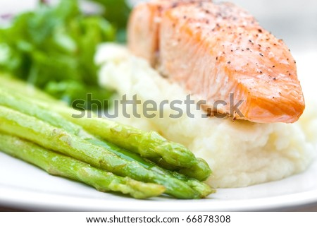 Baked salmon with mash potato and grilled asparagus - stock photo