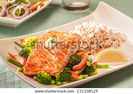 Baked salmon with vegetables and rice