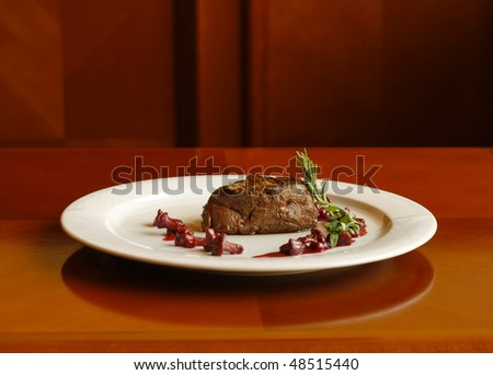 Baked sirloin steak with mushrooms - stock photo
