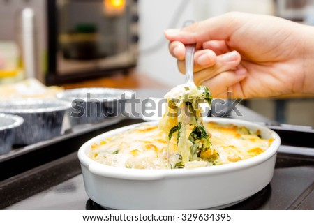 Baked spinach with cheese - stock photo
