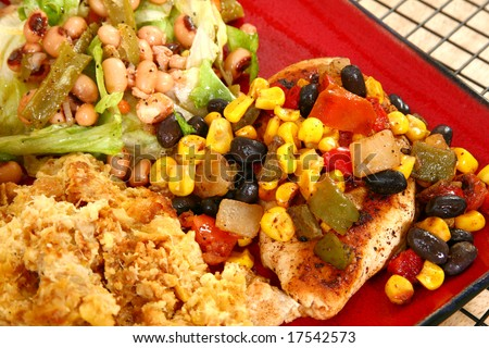 Baked squash with Santa Fe chicken, rolls, baked squash and blackeyed pea salad. - stock photo