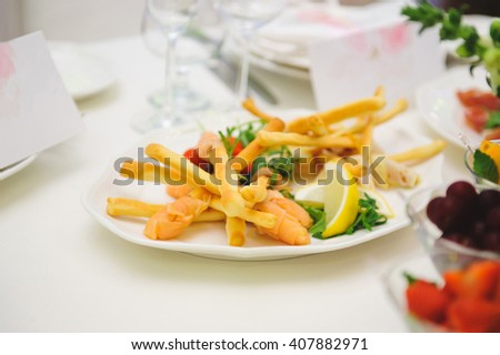 baked sticks with red fish and lemon - stock photo