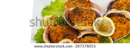 Baked Stuffed Clams. Panoramic image. Selective focus. - stock photo