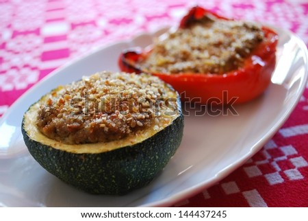 Baked stuffed peppers and zucchini filled with minced tofu with herbs - stock photo