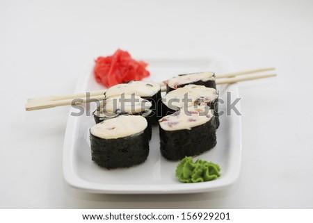 baked sushi rolls - stock photo