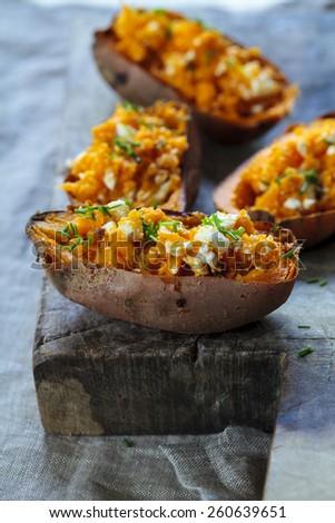 Baked sweet potato with feta cheese - stock photo