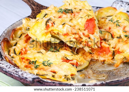 Baked Tomatoes, Zucchini and Potatoes with Thyme and Parmesan Cheese - stock photo