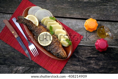 Baked trout fish with potatoes - stock photo