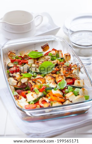 Baked vegetable with sheep cheese and herbs - stock photo