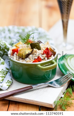 Baked vegetables pilaf. Also available in horizontal format. - stock photo