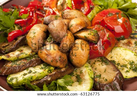 Baked vegetables: potato, zucchini, eggplant on plate. Vegetarian food - stock photo