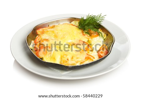 Baked vegetables - zucchini and tomatoes with cheese. Isolated on white by clipping path. - stock photo