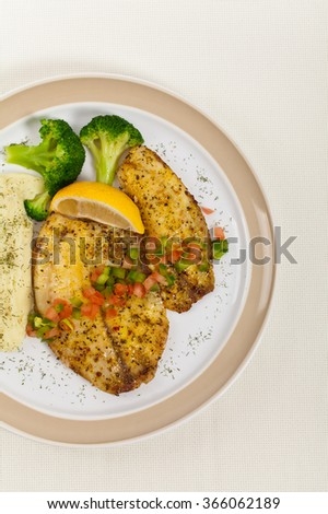 Baked white fish fillet and Mashed Potatoes. Selective focus. - stock photo