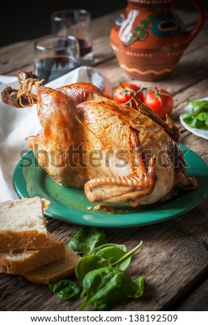 Baked Whole Chicken with fresh vegetables for dinner, selective focus