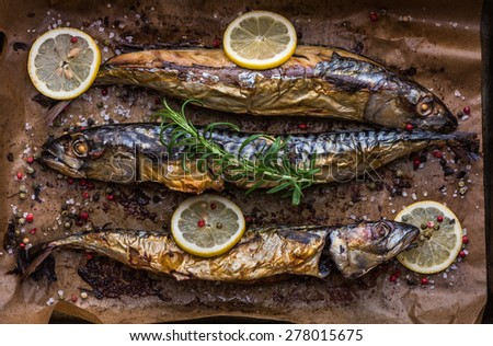 Baked Whole Fish with Spice, Lemon and Rosemary on a Roaster Pan with Baking Paper - stock photo