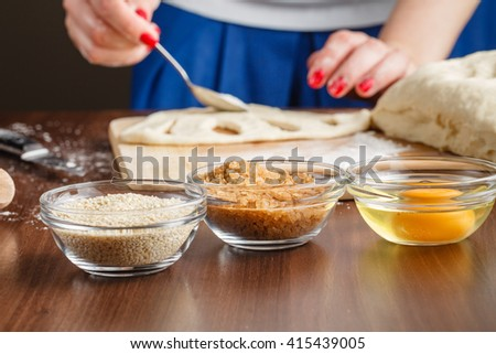 Baker brings dough into the desired shape - stock photo