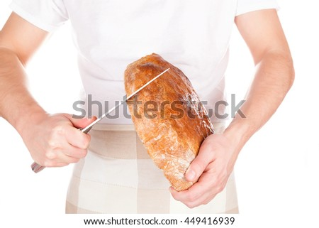 Baker holding and cutting fresh made bread isolated on white background. Baker and bakery. - stock photo