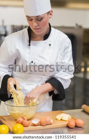 Baker preparing dough for the bread - stock photo