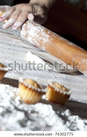 Baker preparing the pastry to make small cakes (selective focus) - stock photo