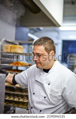 Baker waiting for bread in the oven