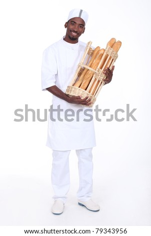 Baker with a basket of baguettes - stock photo
