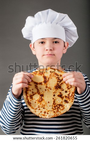 Baker with pancake - stock photo