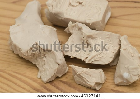 baker yeast on wooden background