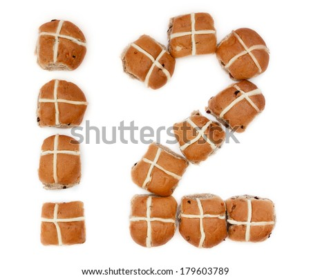 Bakers Dozen of Hot Cross Buns in the shape of the number twelve on white background