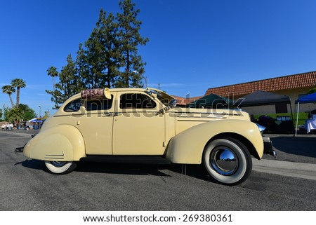 BAKERSFIELD, CA - APR 11, 2015: A 1939 Studebaker Commander is displayed today at the Calvary Baptist Church Spring Car Show. This sedan has fender skirts and even a side-mounted water cooler. - stock photo