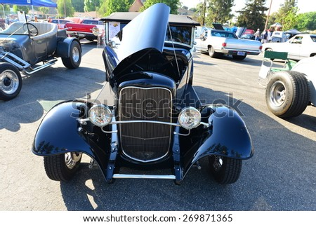 BAKERSFIELD, CA - APR 11, 2015: Eddie Carter's 1932 Ford  Model A roadster made an appearance today at the Calvary Baptist Church Spring Car Show, exhibiting a flawless black paint job.  - stock photo