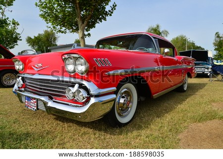BAKERSFIELD, CA-APRIL 19, 2014: The Chevrolet logo is recognized worldwide. There are many in evidence at the Cruisin' For A Wish Car & Motorcycle Show. - stock photo