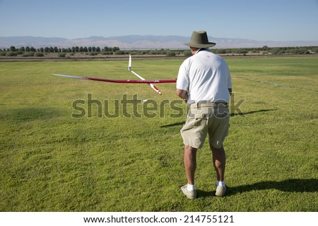 BAKERSFIELD, CA-AUGUST 24, 2014: Gary Ellington guides his sailplane to a precision points landing in the monthly contest hosted by the Southern San Joaquin Soaring Society. - stock photo