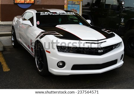 BAKERSFIELD, CA - DECEMBER 13, 2014: A radically-styled Chevrolet Camero SS is on display at the Christmas Joy Ride and Toy Run Car Show charity event held in cool, foggy weather. - stock photo
