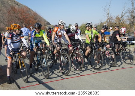 BAKERSFIELD, CA - DECEMBER 6, 2014: Senior men riders are massed at the starting line of the difficult Hart Park Cyclocross. - stock photo