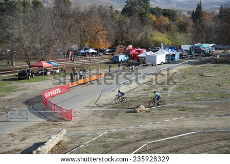 BAKERSFIELD, CA - DECEMBER 6, 2014: The course for the Hart Park Cyclocross is a labyrinth of twists and turns among the hills, unpaved and with lots of mud. - stock photo
