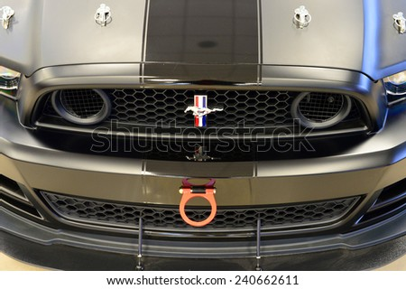BAKERSFIELD, CA - DECEMBER 30, 2014: The front end of the Ford Mustang SHO race car exhibits the special equipment required to compete in auto racing. - stock photo