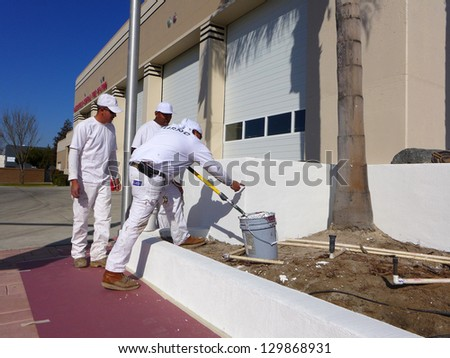 BAKERSFIELD, CA-FEB 28: Carlos Herrera explains work that remains to be done as the repainting of the Central Fire Station is completed on February 28, 2013, in Bakersfield, California.