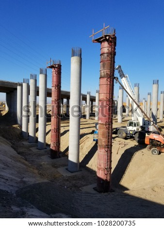 BAKERSFIELD, CA - FEBRUARY 18, 2018: Gigantic concrete columns will soon support the elevated roadway during construction of the Kern River Bridge Improvements Project.