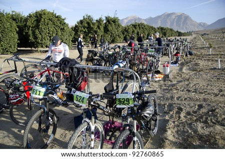 BAKERSFIELD, CA - JAN 14: Contestants arrange their gear in transition area before the Rio Bravo Rumble biathlon (running and mountain biking) on January 14, 2012, in Bakersfield, California. - stock photo