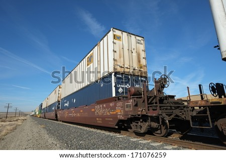 BAKERSFIELD, CA -Â?Â? JAN 11, 2014: Rail cars using versatile intermodal transportation carry containers which can be loaded onto trucks or ships to complete their travel to destinations.