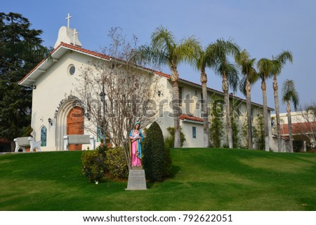 BAKERSFIELD, CA - JANUARY 12, 2018: The architecture of Spanish missions is reflected in the Our Lady of Perpetual Help Catholic Church serving a small neighborhood.