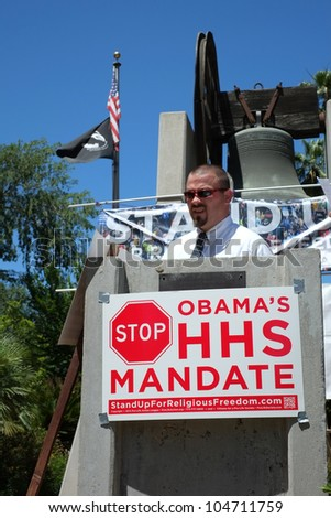 BAKERSFIELD, CA - JUN 8: Organizer Robb Pugh views crowd at the Stand Up for Religious Freedom Rally to protest the HHS health care mandate on June 8, 2012,  in Bakersfield, California.