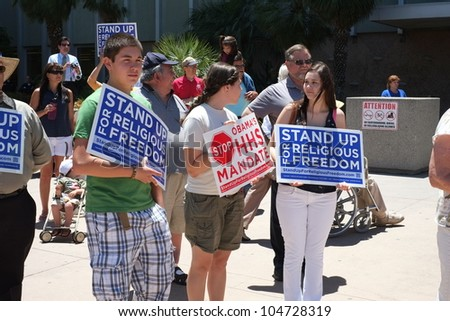 BAKERSFIELD, CA - JUN 8: Unidentified participants show protest signs at the Stand Up for Religious Freedom Rally to object to the HHS health care mandate on June 8, 2012,  in Bakersfield, California. - stock photo