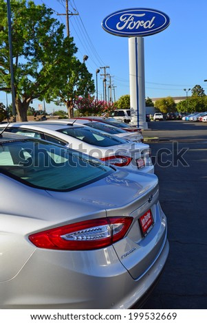 BAKERSFIELD, CA-JUNE 17, 2014:  Tuesday morning and there are no customers looking at new cars at the local Ford dealership. But on the weekend many of these vehicles will be sold. - stock photo