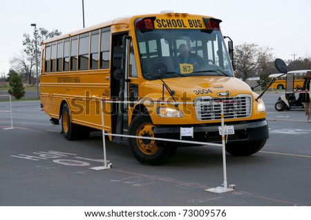 "BAKERSFIELD, CA - MAR 12: The 28th Annual School Bus ""Roadeo"" tests driver skills on March 12, 2011, in Bakersfield, California. Bus negotiates tricky obstacle course."